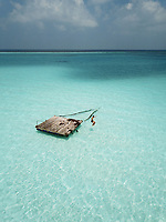 Aerial view of Pontoon in the crystal clear ocean in the Maldives, Indian Ocean