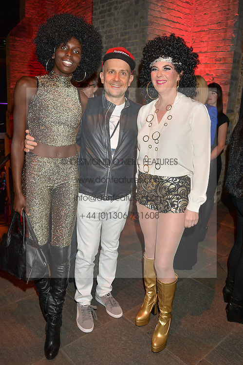 Left to right, JENNY BASET, MARC QUINN and COUNTESS DORA della GHERARDESCA at a Night of Disco in aid of Save The Children held at The Roundhouse, Chalk Farm Road, London on 5th March 2015.