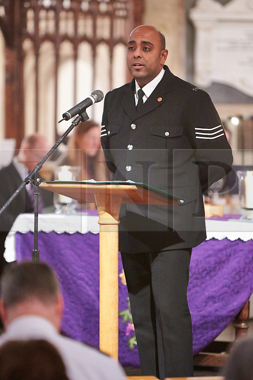 © Licensed to London News Pictures.  17/11/2013. THAME, UK. Sgt Javid Ul-Haq reads verses from the Qu'ran during the annual Road Deaths Memorial Service held in St Marys Church, Thame. 78 people were killed in traffic accidents in the Thames Valley Police area last year.   Photo credit: Cliff Hide/LNP