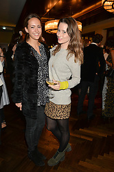 Left to right, LAVINIA BRENNAN and KELLY EASTWOOD at a party to celebrate the 15th anniversary of Myla held at the House of Myla, 8-9 Stratton Street, London on 21st October 2014.