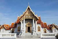 Wat Benchamabophit Dusitvanaram is also known as the marble temple and one of Bangkok's most beautiful temples typifying the ornate Thai style of gables, step roofs and elaborate details.  Construction of the temple began in 1899 at the request of King Chulalongkorn to be near his palace nearby. A picture of the temple's facade is on the Thai five baht coin.