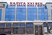 Kaluga, Russia, 15/04/2006..Passengers in dirty Soviet era buses and trolley-buses in the city centre opposite the Twenty First Century Kaluga shopping mall..