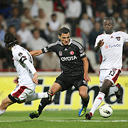 Gaziantepspor's Dany NOUNKEU (R) and Besiktas's Mustafa PEKTEMEK (C) during their Turkish superleague soccer match Gaziantepspor between Besiktas at the Kamil Ocak stadium in Gaziantep Turkey on Monday 03 October 2011. Photo by TURKPIX