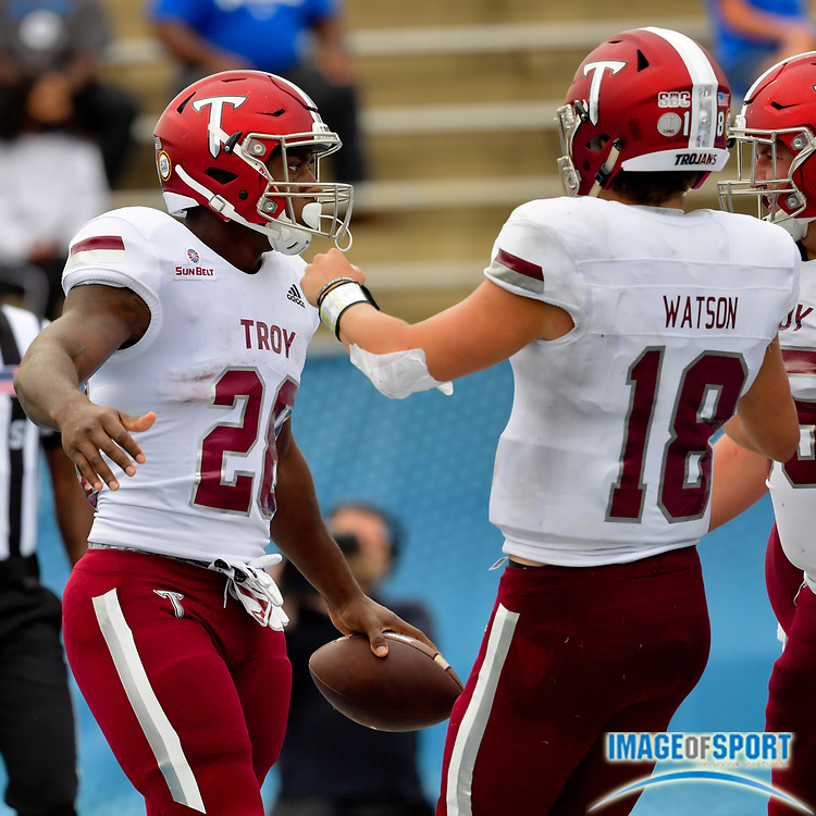 """Troy Trojans running back Charles Strong (28) reacts after scoring a touchdown against the Middle Tennessee Blue Raiders with teammate Troy Trojans quarterback Gunnar Watson (18) during the first half at Johnny """"Red"""" Floyd Stadium in Murfreesboro, Tenn., Saturday, Sept. 19, 2020. (Jim Brown/Image of Sport)"""