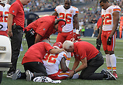 Aug 25, 2017; Seattle, WA, USA; Kansas City Chiefs running back Spencer Ware (32) is examined by trainers after suffering a knee injury as coach Andy Reid and running back C.J. Spiller (26) and cornerback Marcus Peters (22) watch during a NFL football game against the Seattle Seahawks at CenturyLink Field.