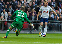Football - 2017 / 2018 Premier League - Tottenham Hotspur vs. Liverpool<br /> <br /> Harry Kane (Tottenham FC)  takes the ball around the on rushing Simon Mignolet (Liverpool FC)  before scoring the opening goal at Wembley Stadium.<br /> <br /> COLORSPORT/DANIEL BEARHAM