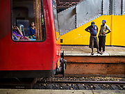07 OCTOBER 2017 - COLOMBO, SRI LANKA: Workers look at the track they have to remove as soon as the outgoing train clears the station at the Fort Station in Colombo. The Fort Station is Colombo's main train station and serves as the hub of Sri Lanka's train system. The station opened in 1917 and is modeled after Manchester Victoria Station.    PHOTO BY JACK KURTZ