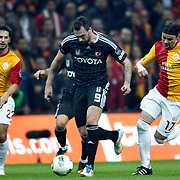 Galatasaray's Tomas Ujfalusi (R) and Besiktas's Hugo Almeida (C) Multiple Players during their Turkish superleague soccer derby match Galatasaray between Besiktas at the TT Arena at Seyrantepe in Istanbul Turkey on Sunday, 26 February 2012. Photo by TURKPIX