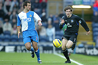 Fotball<br /> Premier League England 2004/2005<br /> Foto: SBI/Digitalsport<br /> NORWAY ONLY<br /> <br /> Blackburn v Everton<br /> Barclays Premiership. 18/12/2004. <br /> <br /> Kevin Kilbane of Everton chases for the ball with Lucas Neill of Blackburn Rovers.