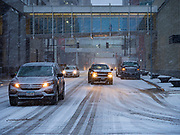 10 JANUARY 2020 - DES MOINES, IOWA: Traffic on 7th Ave in downtown Des Moines during a snowstorm Friday. The first significant snow in two months blanketed Des Moines Friday evening. Meteorologists are predicting up to six inches of snow overnight and have issued a winter storm warning for southern and central Iowa. Most schools in the affected area closed early and cancelled afternoon events. Some presidential candidates, campaigning ahead of the Iowa Caucuses, cancelled their events.    PHOTO BY JACK KURTZ