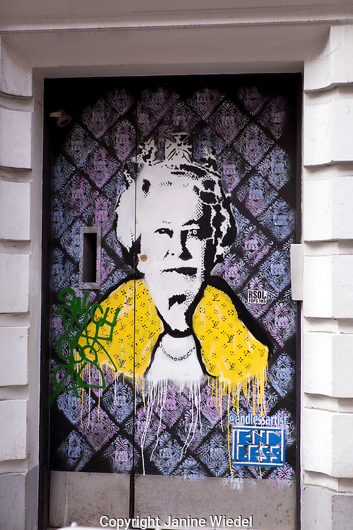 Stencil street art by Endless  of Queen Elizabeth in London