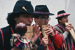 Band of street performers playing pan pipes,