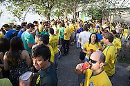 Brazil fans gather at the top of Morro da Urca, the halfway stop on the way to Sugarloaf, for a big party and to watch the match between Brazil and Mexico. Scenes from Rio de Janeiro on the day that Brazil drew 0-0 with Mexico. Photo by Andrew Tobin/Tobinators Ltd