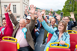 © Licensed to London News Pictures. 20/07/2019. Brecon, Powys, Wales, UK. Brexit Party supporters are in high spirits as they tour Brecon in the Brexit Bus. The Brexit Party, with  Brecon & Radnorshire constituency candidate Des Parkinson, bring their campaign to the small Welsh market town of Brecon in Powys, UK. in a bid to win the seat in the forthcoming Brecon & Radnorshire constituency by-election on the 1st August 2019. The Brexit Party was founded by former UKIP economics spokeswoman, Catherine Blaiklock in January 2019, and is led by Nigel Farage. The Brexit party has 29 Members of the European Parliament (MEPs) and four Welsh Assembly Members. The party's first major electoral success was winning the 2019 European Parliament election in the United Kingdom after four months in existence. Photo credit: Graham M. Lawrence/LNP