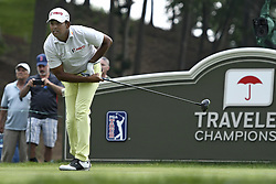 June 24, 2018 - Cromwell, CT, USA - Anirban Lahiri watches his tee shot on the 18th hole during the final round of the Travelers Championship at TPC River Highlands in Cromwell, Conn., on Sunday, June 24, 2018. (Credit Image: © John Woike/TNS via ZUMA Wire)