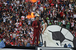 June 14, 2018 - Moscow, Russia - Russian Federation. Moscow. The Luzhniki Stadium. Match Opening of the World Cup 2018. Russia - Saudi Arabia. Solemn opening ceremony of the FIFA World Cup 2018. FIFA World Cup 2018. Player of the Russian national football team (in red).Robbie Williams; Aida Garifullina. (Credit Image: © face to face via ZUMA Press)