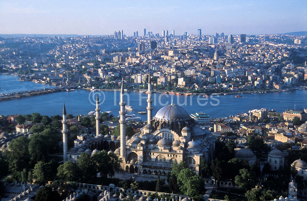 Aerial view of Istanbul city scape, with the Suleymanie Mosque ( built AD: 1550-1560) in foreground, the Golden Horn and modern Istanbul in the background, Turkey.