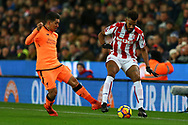 Roberto Firmino of Liverpool (l) looks to tackle Eric Maxim Choupo-Moting of Stoke City. Premier league match, Stoke City v Liverpool at the Bet365 Stadium in Stoke on Trent, Staffs on Wednesday 29th November 2017.<br /> pic by Chris Stading, Andrew Orchard sports photography.
