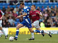 Photo. Leigh Quinnell.  Reading v West Ham United Coca Cola championship. 12/03/2005. Readings Glen Little keeps the ball from West Hams Matthew Etherington.
