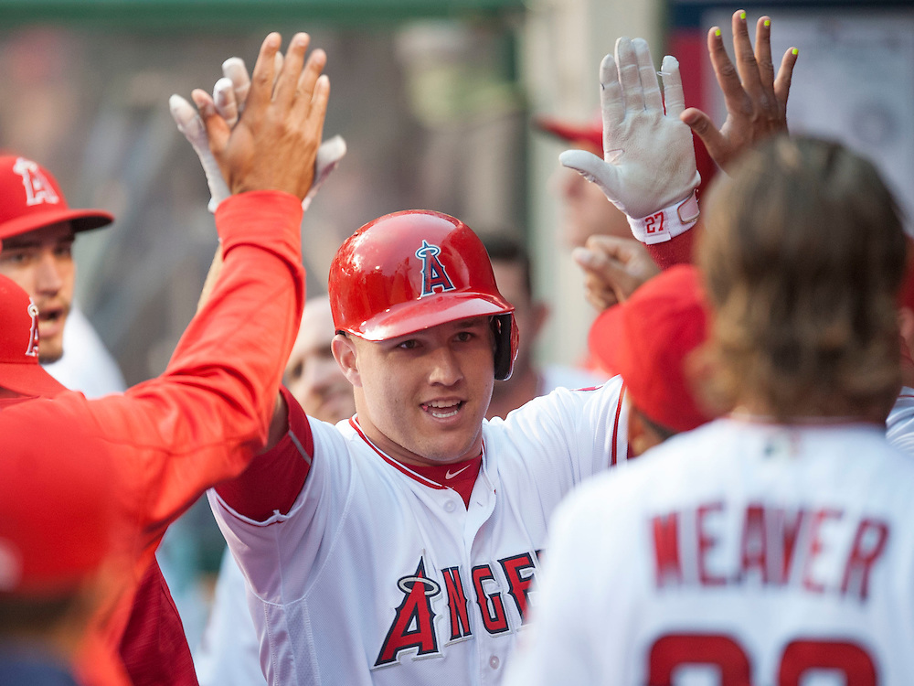 Mike Trout celebrates after his solo home run in the first inning against the Houston Astros Saturday at Angel Stadium.<br /> <br /> ///ADDITIONAL INFO:   <br /> <br /> angels.0529.kjs  ---  Photo by KEVIN SULLIVAN / Orange County Register  -- 5/28/16<br /> <br /> The Los Angeles Angels take on the Houston Astros Saturday at Angel Stadium.