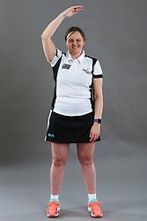 Umpire Rachael Radford signalling caution