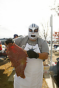Rudy Ramon from Corpus Christi prepares a slab of steak in parking lot 4 before the Cowboys game against the Pittsburgh Steelers at Cowboys Stadium in Arlington, Texas, on December 16, 2012.  Ramon and his friends could not find tickets, so they will watch the game on a t.v. in the back of his truck.  (Stan Olszewski/The Dallas Morning News)
