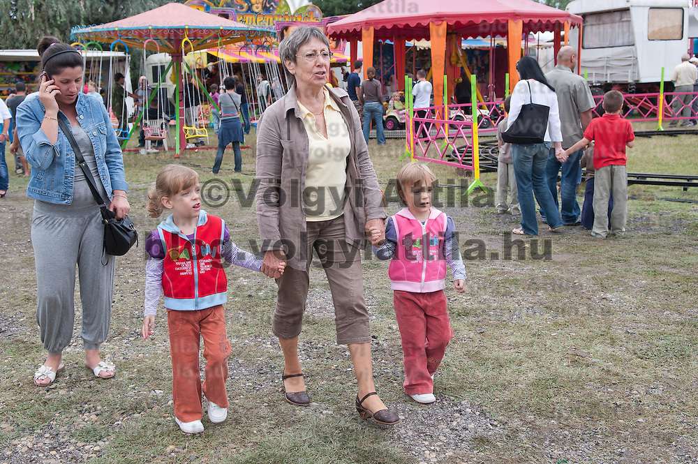 A family with twin girls 12th Twin Festival held 7th time in Szigehalom (about 15 km from Budapest), Hungary on July 23, 2011. ATTILA VOLGYI