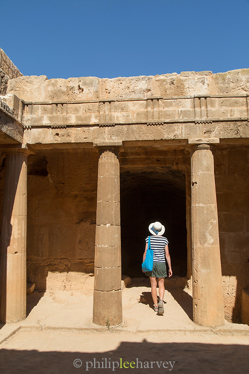 Female tourist walking into old ruins, Paphos Archaeological Park, Paphos, Cyprus