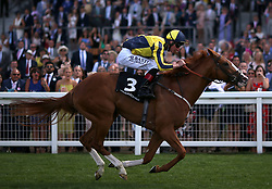 Crack On Crack On ridden by jockey Adam Kirby wins the Porsche Handicap during King George Day at Ascot Racecourse.
