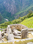 The Incan ruins of the Temple of the Sun at Machu Picchu, near Aguas Calientes, Peru.