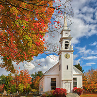 New England fall foliage photography of the historic white steeple Community Church of Sandwich in the Squam Lake region of New Hampshire.<br />