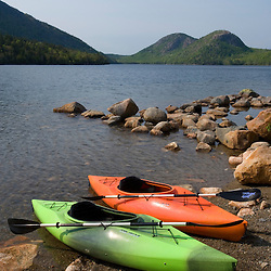 "Kayaks on the shore of Jordan Pond in Maine's Acadia National Park.  ""The Bubbles"" are in the distance."