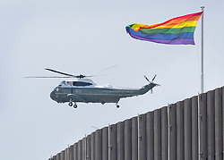 © Licensed to London News Pictures. 03/06/2019. London, UK. Marine One, Presidential helicopter, flies past a building displaying an LGBT rainbow flag in sight of Buckingham  Palace as President Donald Trump arrives during his State Visit to the United Kingdom. During his three days in the UK he will meet with members of the Royal family and outgoing Prime Minister Theresa May before attending 75th Anniversary of D-Day commemorations in Portsmouth and France. Photo credit: Peter Macdiarmid/LNP