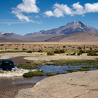 Driving through large puddles or ungraveled roads was very funny and indeed the only way to cross the National Parks. But at this time we were asking if we were still driving through Bolivia, crossing no man's land, or were we unconsciously driving again on chilean soil?