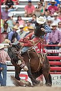 Rookie Saddle Bronc rider J.W. Meiers is tossed from horse James Bond at the Cheyenne Frontier Days rodeo at Frontier Park Arena July 24, 2015 in Cheyenne, Wyoming. Frontier Days celebrates the cowboy traditions of the west with a rodeo, parade and fair.