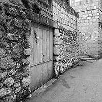 15, Garage blue door with stone wall street;<br />Split, Croatia. 2018
