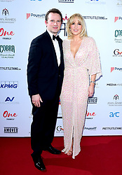 Conrad Baker (left) and his wife Emma Noble attending the 8th Annual Asian Awards held at the Hilton Hotel, Park Lane, London.