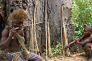 Hadza men prepare arrows before a hunting expedition Photographed at Lake Eyasi, Tanzania