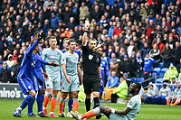 Football - 2018 / 2019 Premier League - Cardiff City vs. Chelsea<br /> <br /> referee Mr C. Pawson gives a yellow card to Lee Peltier of Cardiff City causing protests from Cardiff players, at Cardiff City Stadium.<br /> <br /> COLORSPORT/WINSTON BYNORTH