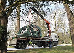 ©London News pictures. 28/03/2011. The sculpture is lifted from the lorry. Workers install Henry Moore's 'Hill Arches (lH636)' at the historic Hatfield House, Hertfordshire today (Mon). The iconic bronze sculpture weighs in at 5400Kilos (5.4 Ton) and needed a special trackway to be built ahead of it's arrival on a truck. The scultpure forms part of an exhibition which is open to the public 23rd April to 30th September 2011. Hatfield House was the former home of Elizabeth 1st. Picture credit should read Stephen Simpson/LNP