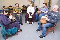 A group of visually impaired people playing drums in a drumming workshop at the NRSB activity day at their centre on Ortzen Street,  This is part of the IMPACT project; an interactive road show delivering a series of events designed to give the visionimpaired community of Nottinghamshire the opportunity to IMPACT on the future of Notts Royal Society for the Blind,