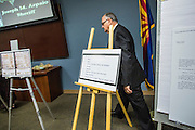 17 JULY 2012 - PHOENIX, AZ: Maricopa County Sheriff JOE ARPAIO walks into a press conference at his office Tuesday. Mike Zullo, Arpaio's volunteer investigator, and Arpaio said their investigation proves that the long form birth certificate President Barrack Obama has used to prove his citizenship is a fraud. They further said that Hawaii's lax standards for getting a birth certificate may pose a serious flaw to the United States' national security. PHOTO BY JACK KURTZ