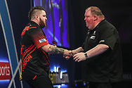 Michael Smith and John Henderson at the end of their first round match during the World Darts Championships 2018 at Alexandra Palace, London, United Kingdom on 27 December 2018.
