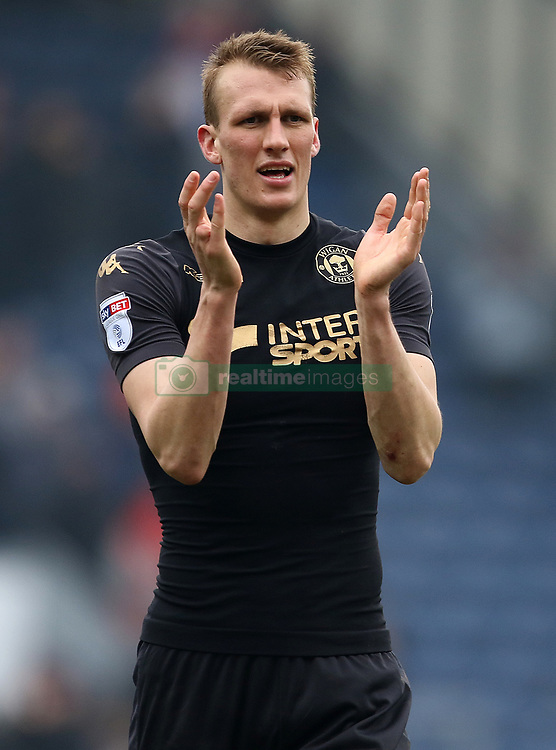 Wigan Athletic's Dan Burn applauds the fans after the final whistle