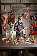 Marcus Dirr, a master butcher with one day's worth of food in his shop in Endingen, Germany, near Freiburg im Breisgau. (From the book What I Eat: Around the World in 80 Diets.) The caloric value of his typical day's worth of food in March was 4600 kcals. He is 43 years of age; 5 feet, 9 inches tall; and 160 pounds.  Germans are among the biggest meat eaters in Europe, but eat slightly less meat than in decades past.  MODEL RELEASED.