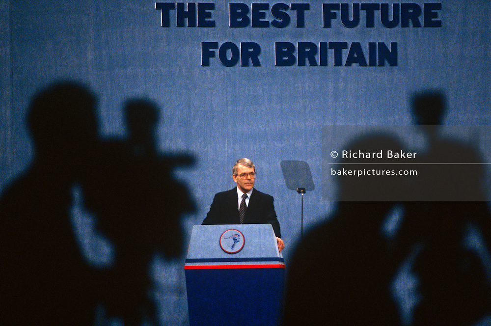 Prime Minister John Major is under the scrutiny of media TV cameras during the 1991 tory party conference.