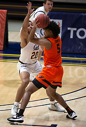 Feb 25, 2021; Berkeley, California, USA; Oregon State Beavers guard Ethan Thompson (5) looks to pass around California Golden Bears forward Andre Kelly (22) during the first half of an NCAA college basketball game at Haas Pavilion. Mandatory Credit: D. Ross Cameron-USA TODAY Sports