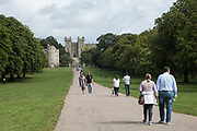 Visitors and local residents take a stroll on the Long Walk in front of Windsor Castle on 23rd August 2020 in Windsor, United Kingdom. The Sunday Times has reported that the Queen will make Windsor Castle her main home for the rest of the year following her summer break at Balmoral rather than returning to Buckingham Palace because her household arrangements at Windsor Castle are believed to offer the greatest protection from COVID-19.