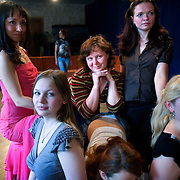 """Russian students learn to be """"real women"""" under Vladimir Rakovsky, a self-proclaimed master of seduction. The course, given in Moscow, includes seduction theory, posture and strip-tease. The course, also dubbed """"How to Marry a Millionaire"""", teaches women to be subservient to men. .The course takes place at the Dubrovka Theatre, scene of the terrorist siege."""