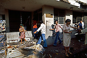 After a Sandinista attack and looting, Masaya townspeople carry off bank property from the National Bank of Nicaragua. Civil War in Nicaragua - 1978
